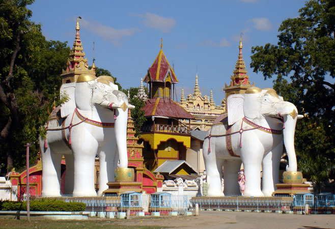 Two giant white elephants guarding the entrance of Thanboddhay Pagoda