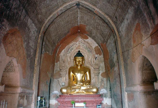Gilded Buddha in prayer hall