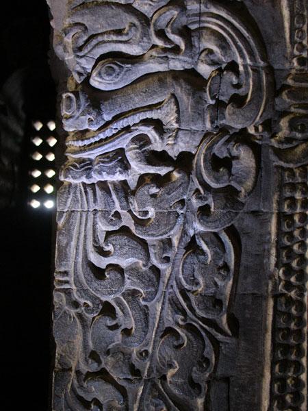 Ogre figure on the column inside Nan Paya