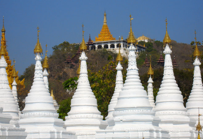 Stupas and Mandalay Hill in background